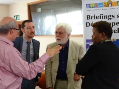 Alexandros Ragoussis (G), James Putzel (C) et Annick Sezibera (D)